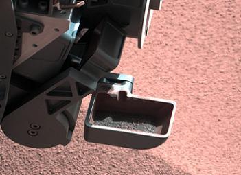 MSL Scoops Mars Dirt
