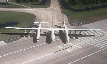 Stratolaunch rolling out on to Runway 33 at the SLF