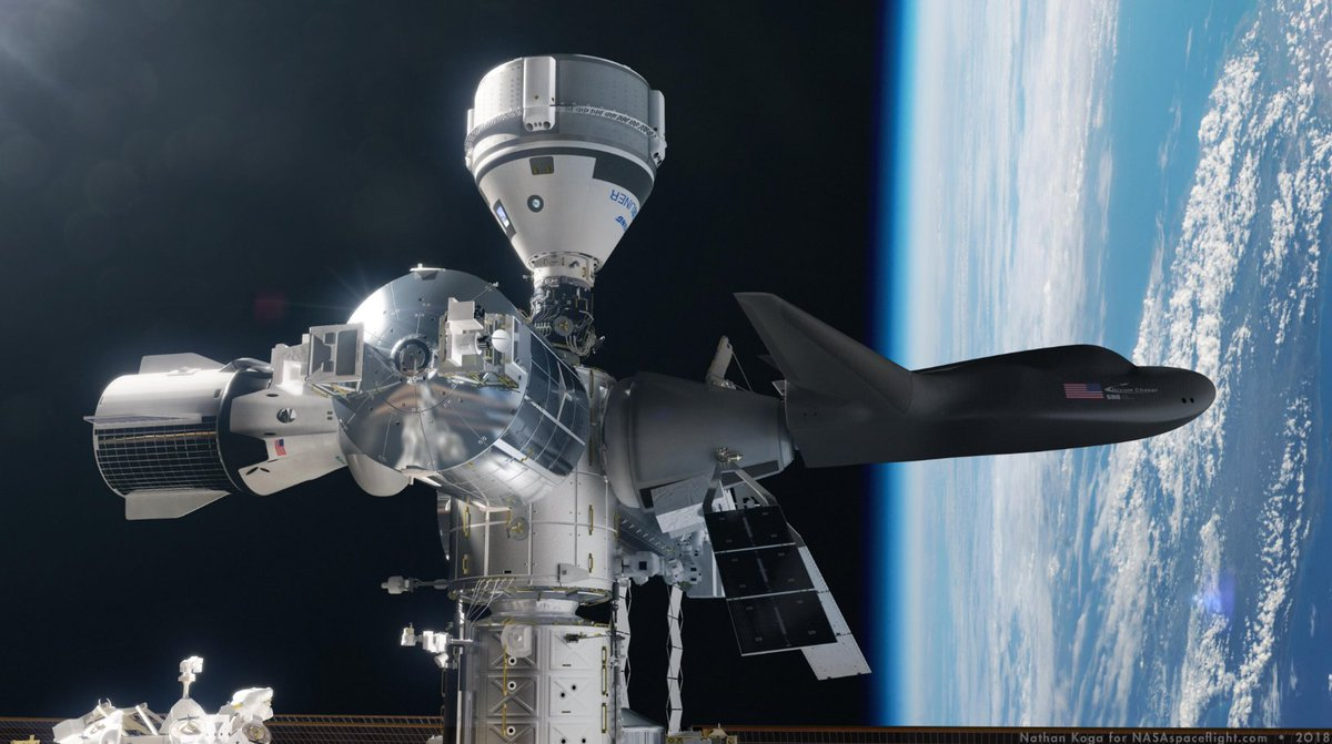 Spacewalking NASA astronauts add parking spot to space station