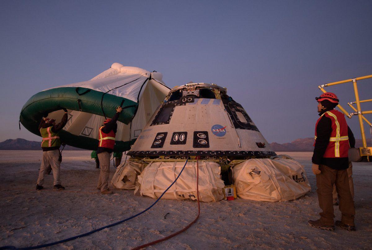 Teams process the Starliner vehicle after landing. Credit NASA