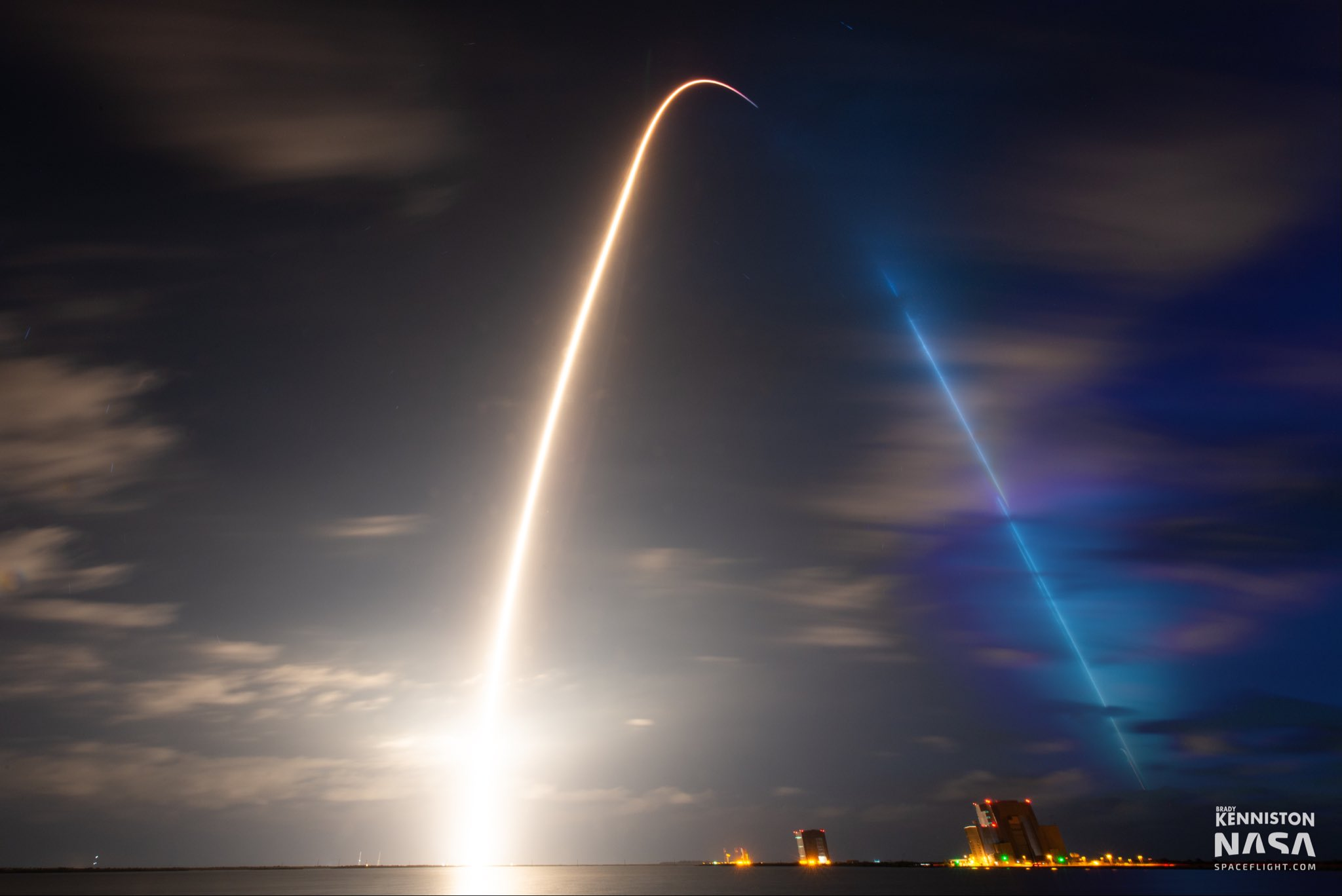 Off the Earth, for the Earth; Endeavour lifts off with international crew for six month mission
